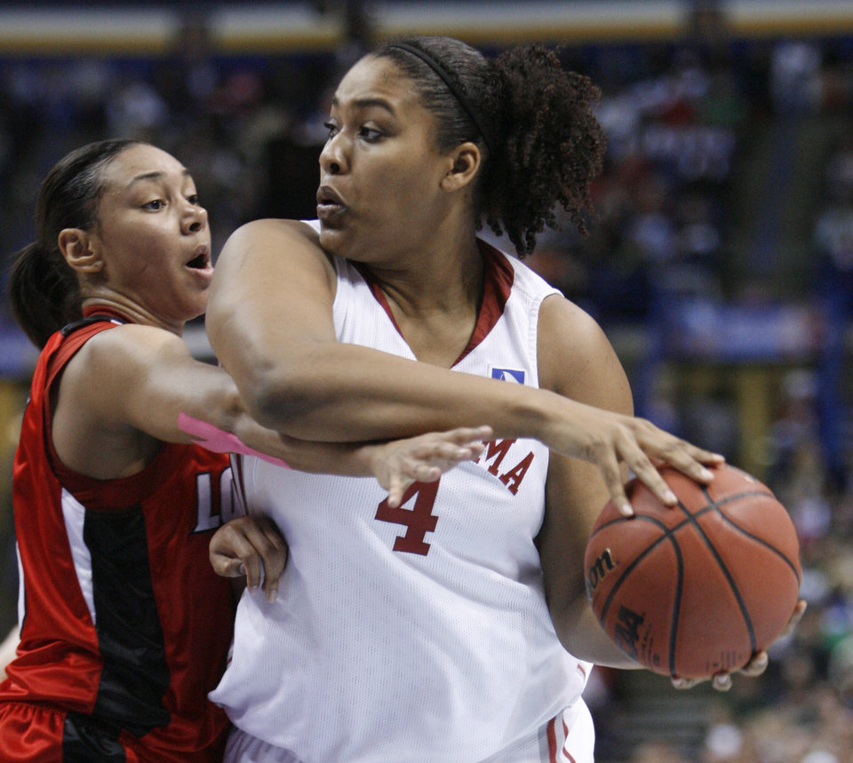 Photo - Abi Olajuwon is guarded by Candyce Bingham (13) in the first half as the University of Oklahoma plays Louisville at the 2009 NCAA women's basketball tournament Final Four in the Scottrade Center in Saint Louis, Missouri on Sunday, April 5, 2009. 