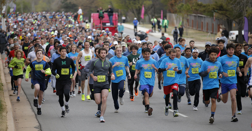 Photo -  Runners compete Sunday in the 5k during the Redbud Classic in Oklahoma City. [Photo by Sarah Phipps, The Oklahoman]