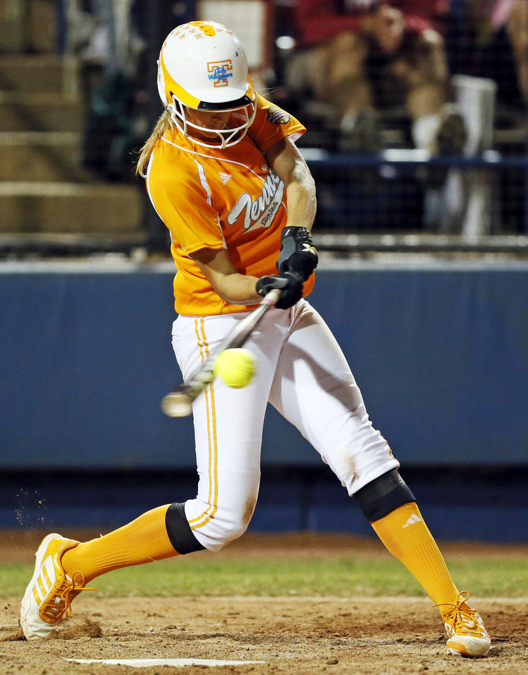 Photo - Tennessee's Madison Shipman (44) hits a three-run home run in the eleventh inning during Game 1 of the Women's College World Series NCAA softball championship series between Oklahoma and Tennessee at ASA Hall of Fame Stadium in Oklahoma City, Monday, June 3, 2013. OU won 5-3 in 12 innings. Photo by Nate Billings, The Oklahoman