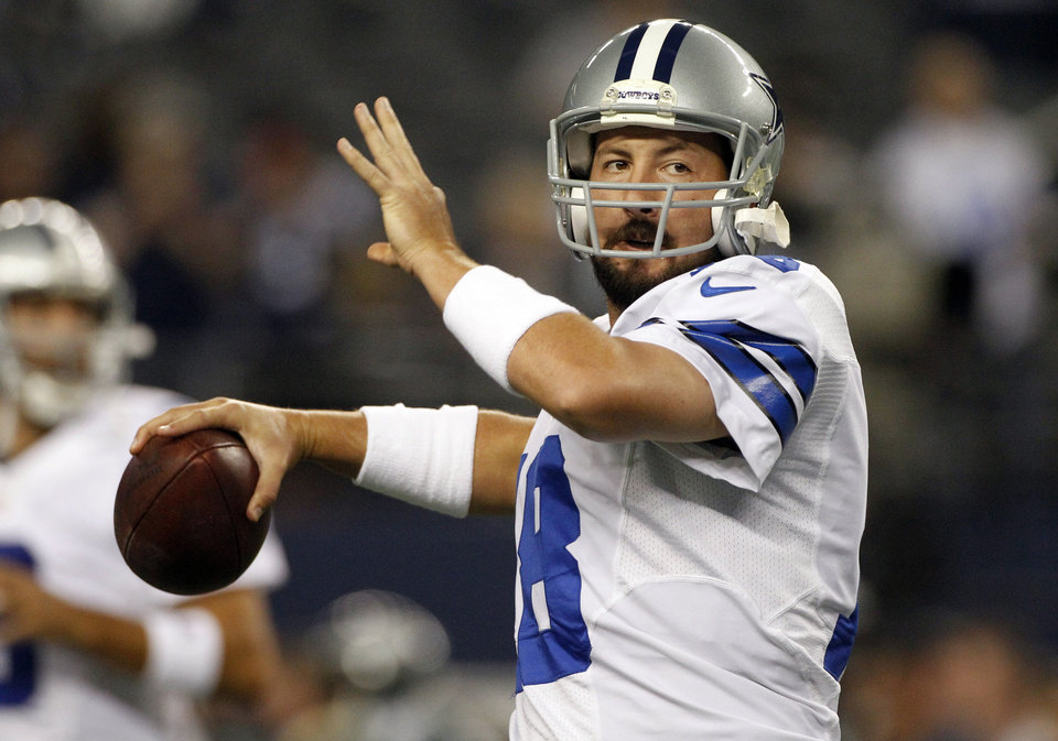 Photo - FILE - In this Sunday Dec. 2, 2012 file photo, Dallas Cowboys quarterback Kyle Orton (18) passes the ball before an NFL football game against the Philadelphia Eagles  in Arlington, Texas. The Dallas Cowboys are releasing Kyle Orton after their backup quarterback missed all the offseason workouts amid reports that he was considering retirement, Tuesday, July 15, 2014.(AP Photo/Tony Gutierrez, File)