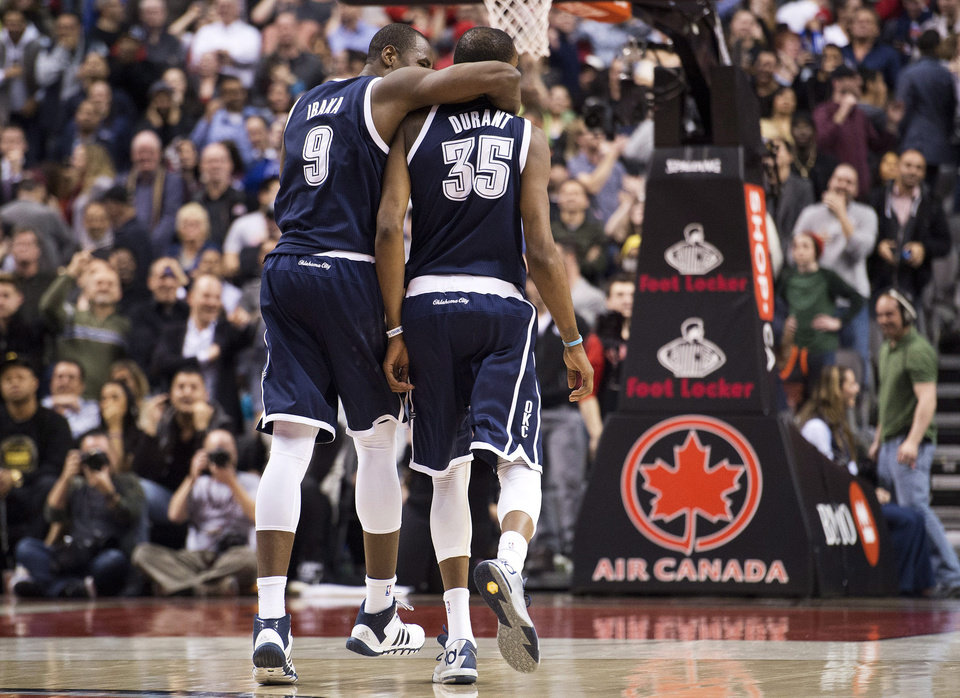 Photo -  Kevin Durant went up to Canada and dropped 51 points on the Toronto Raptors in one of the games of the season. The Thunder won 119-118 in double overtime. (AP Photo/The Canadian Press, Nathan Denette)