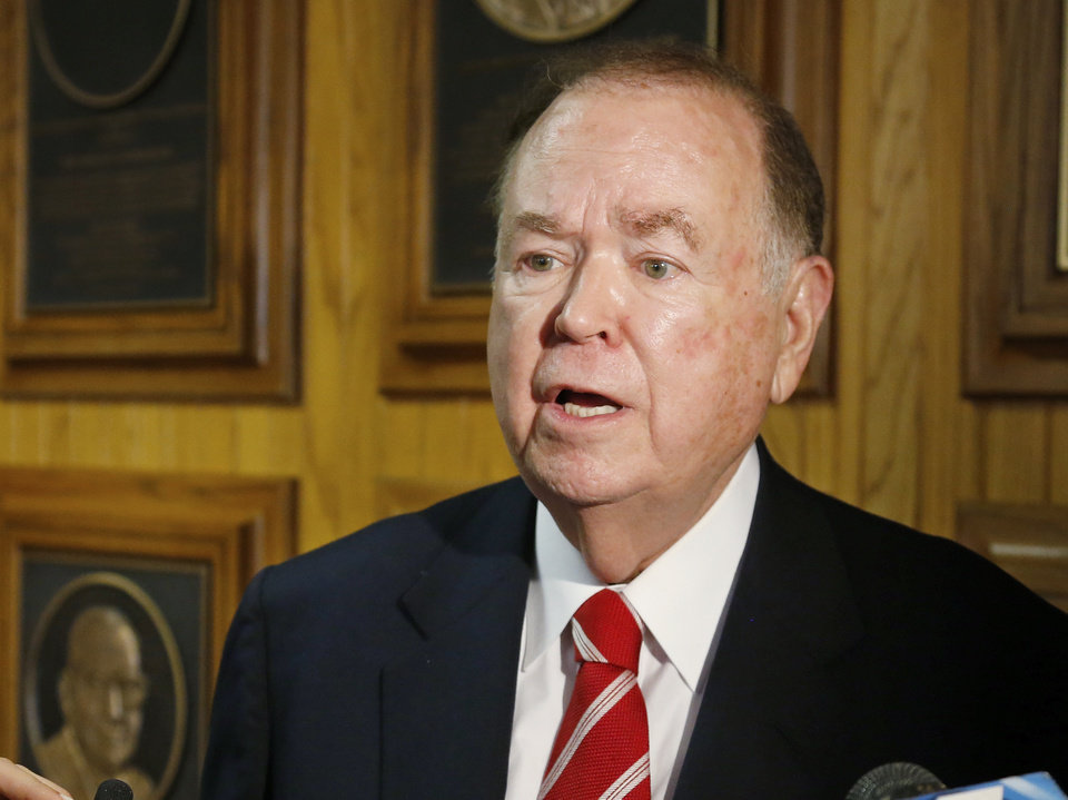 Photo - FILE - In this March 10, 2015 file photo, University of Oklahoma President David Boren talks with the media before the start of a Board of Regents meeting in Oklahoma City.  The attorney for Boren says Boren has met with investigators looking into allegations he sexually harassed male subordinates.  Attorney Clark Brewster told The Oklahoman that Boren met Friday, April 5, 2019  with investigators and answered all of their questions, but Brewster declined to discuss specific questions. [AP photo]