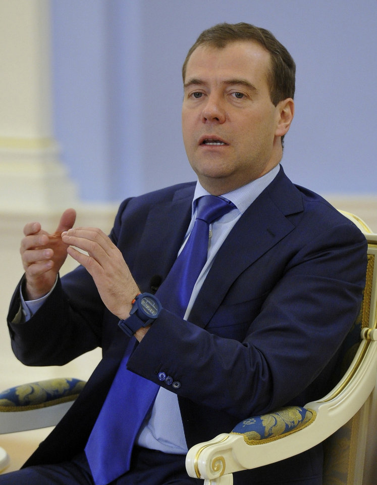 Photo -   Russian Prime Minister Dmitry Medvedev, right, speaks during his meeting with Russian pupils, in the Gorki residence outside Moscow, Russia, on Friday, Nov. 2, 2012. Medvedev said Friday that he detested the Pussy Riot act, but added the women have been in prison long enough and should be released. (AP Photo/RIA-Novosti, Alexander Astafyev, Government Press Service)