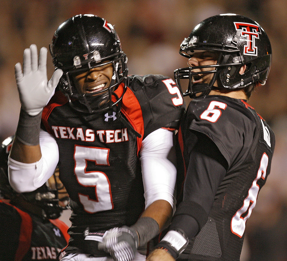 Texas Tech\'s Michael Crabtree (5) and Graham Harrell (6) celebrate after a Crabtree touchdown during the first half of the college football game between the Oklahoma State University Cowboys (OSU) and the Texas Tech Red Raiders at Jones AT&T Stadium on Saturday, Nov. 8, 2008, in Lubbock, Tex. BY CHRIS LANDSBERGER/THE OKLAHOMAN