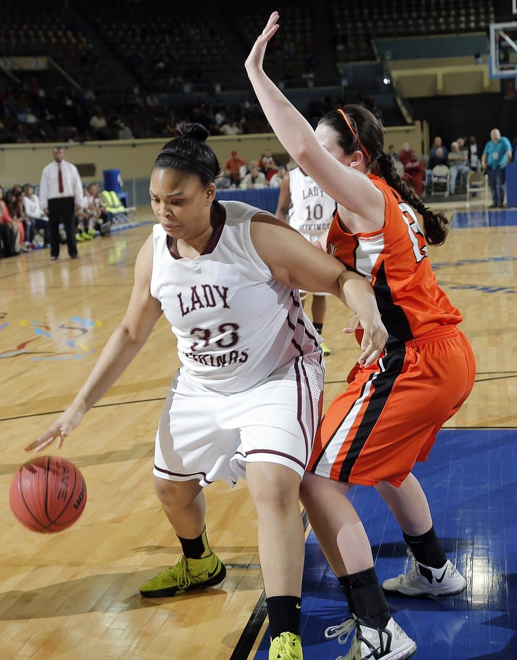 Northeast's Chanel Akins (33) drives against Fairview's Baylor Reese (13) during the state high school basketball tournament Class 2A girls semifinal game between Fairview High School and Northeast High School at the State Fair Arena on Friday, March 8, 2013, in Oklahoma City, Okla. Photo by Chris Landsberger, The Oklahoman