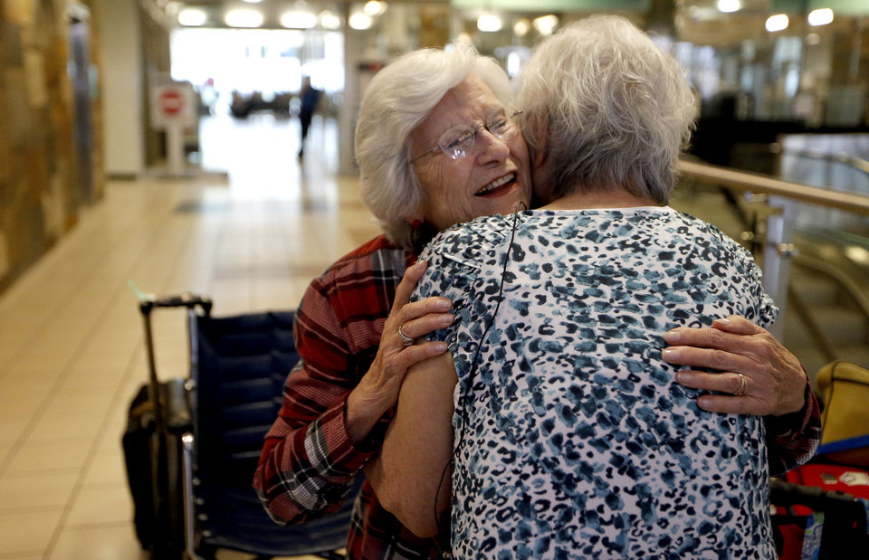 Photo - Sadie Fanali , left, and Lorraine Thomas meet for the first time at Will Roger World Airport, Friday, June 14, 2013, in Oklahoma City.  The pair have been pen pals since 1932. Photo by Sarah Phipps, The Oklahoman