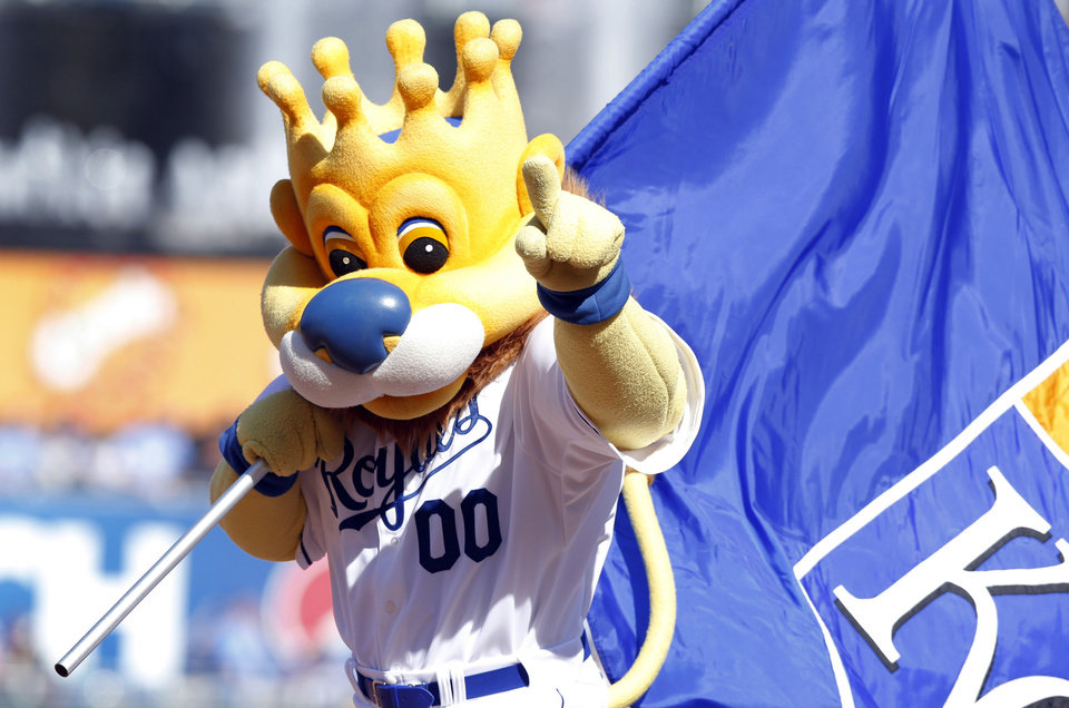Photo - Kansas City Royals mascot Sluggerrr celebrates following a baseball game against the Chicago White Sox at Kauffman Stadium in Kansas City, Mo., Saturday, April 5, 2014. The Royals won Sox 4-3. (AP Photo/Orlin Wagner)