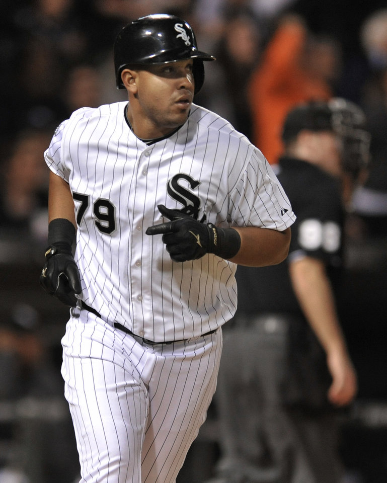 Photo - Chicago White Sox's Jose Abreu watches his solo home run during the seventh inning of a baseball game against the Arizona Diamondbacks in Chicago, Friday, May 9, 2014. (AP Photo/Paul Beaty)
