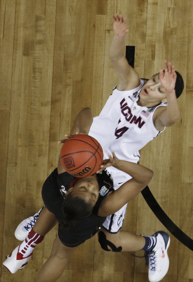Photo - Stanford guard Amber Orrange (33) shoots against Connecticut guard Bria Hartley (14) during the second half of the semifinal game in the Final Four of the NCAA women's college basketball tournament, Sunday, April 6, 2014, in Nashville, Tenn. (AP Photo/John Bazemore)