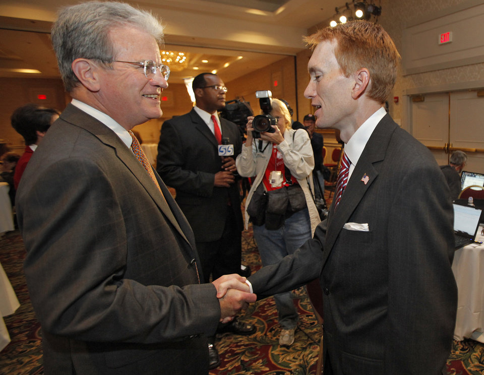 Photo - U.S. Senator Tom Coburn talks to James Lankford at the republican Watch Party at the Marriott on Tuesday, Nov. 2, 2010, in Oklahoma City, Okla.   Photo by Chris Landsberger, The Oklahoman