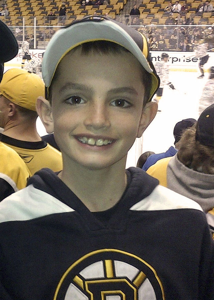 Photo - FILE - This April 11, 2013 photo provided by the Richard family shows, Martin Richard, 8, in Boston. Martin was the youngest of three people killed in the  Monday, April 15, 2013, bombings near the finish line of the Boston Marathon. The charitable foundation started by his parents announced Thursday, Jan. 30, 2014, it had selected 72 runners from more than 250 people in 35 states and several other countries who submitted 11-page applications to run as a team in the marathon on April 21, 2014. Charity teams are forming to run in honor of victims of the bombings at last year's race. (AP Photo/Bill Richard, File)