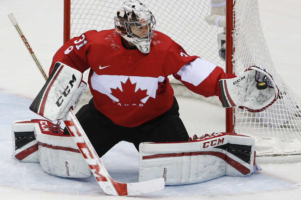Photo - Goalkeeper Carey Price of Canada (31) catches a shot on the goal during the second period of the men's gold medal ice hockey game against Sweden at the 2014 Winter Olympics, Sunday, Feb. 23, 2014, in Sochi, Russia. (AP Photo/Petr David Josek)