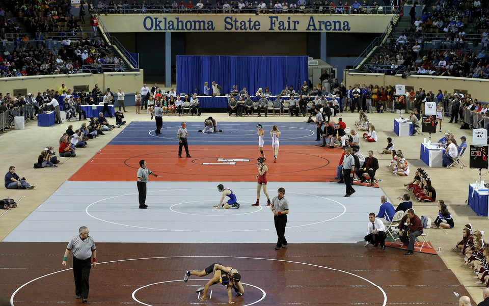 Photo - Wrestlers compete during the state wrestling championships at the State Fair Arena in Oklahoma City, Saturday, Feb. 23, 2013. Photo by Bryan Terry, The Oklahoman