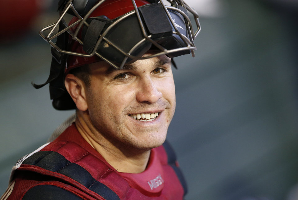 Photo - Arizona Diamondbacks' Miguel Montero smiles in the dugout prior to the Diamondbacks' spring training baseball game against the Chicago Cubs, Friday, March 28, 2014, in Phoenix. (AP Photo/Ross D. Franklin)