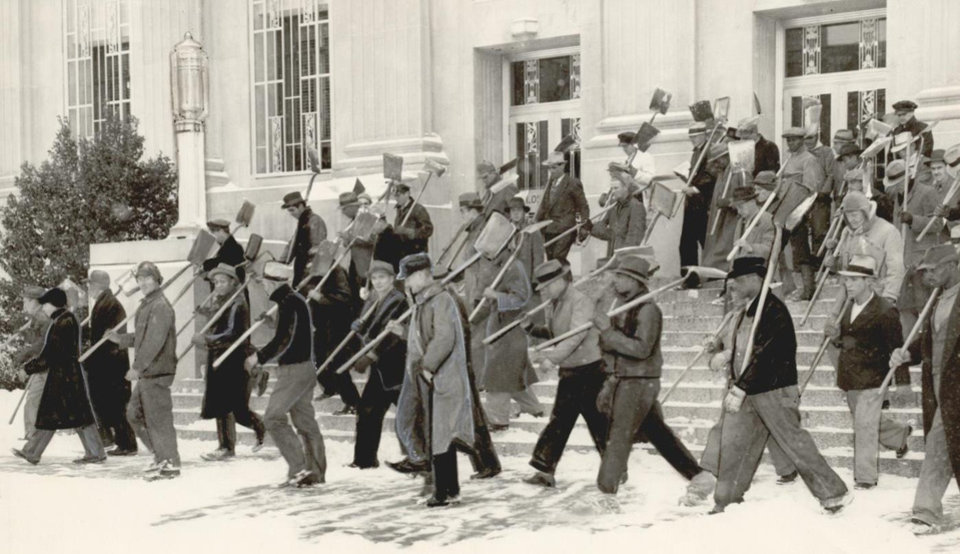 Photo - Jan. 6, 1940: A group of 250 unemployed men and armed with shovels were sent out to clear downtown Oklahoma City streets of snow. Each man was paid 50 cents plus 50 cents in relief grocery order. [Photo by George Cauthen, The Oklahoman Archives]