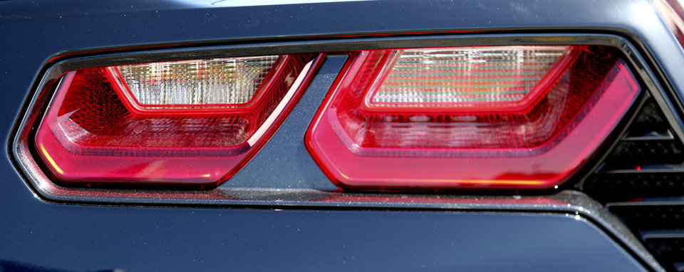 Photo - The tail light of a 2014 Chevrolet Corvette on display at Frontier Chevrolet in El Reno, Monday August  25, 2014. Corvette enthusiast made a stop in El Reno on their cross country trip in National Corvette Caravan.  Photo By Steve Gooch, The Oklahoman