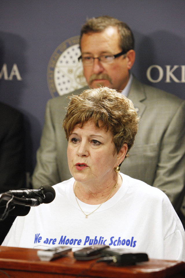 Photo - Susan Pierce, superintendent of Moore Public Schools, speaks during a press conference Thursday announcing the formation of Shelter Oklahoma Schools at the state Capitol in Oklahoma City. State Reps. Jon Echols, Mark McBride, Richard Morrissette, Eric Proctor and John Trebilcock formed the entity with the purpose of helping provide storm shelter or safe rooms for existing schools. Photo by Paul B. Southerland, The Oklahoman  PAUL B. SOUTHERLAND - PAUL B. SOUTHERLAND