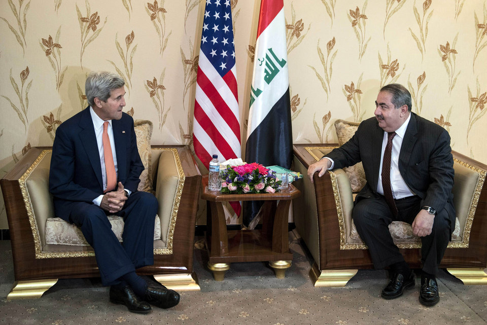 Photo - U.S. Secretary of State John Kerry, left, meets with Iraqi Foreign Minister Hoshyar Zebari in Baghdad, Iraq, Monday, June 23, 2014. Kerry flew to Baghdad on Monday to meet with Iraq's leaders and personally urge the Shiite-led government to give more power to political opponents before a Sunni insurgency seizes more control across the country and sweeps away hopes for lasting peace. (AP Photo/Brendan Smialowski, Pool)