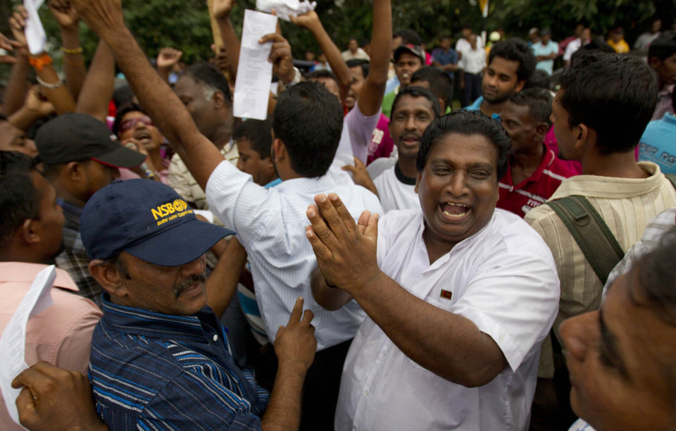 Photo - Supporters of Sri Lanka's president Mahinda Rajapaksa celebrate upon hearing the result of the vote to  impeach the country's Chief Justice Shirani Bandaranayake in Colombo, Sri Lanka, Friday, Jan 11, 2013. Sri Lanka's Parliament voted overwhelmingly on Friday to impeach the chief justice, deepening a standoff between the judiciary and the government, which is controlled by the country's most powerful family. (AP Photo/Gemunu Amarasinghe)