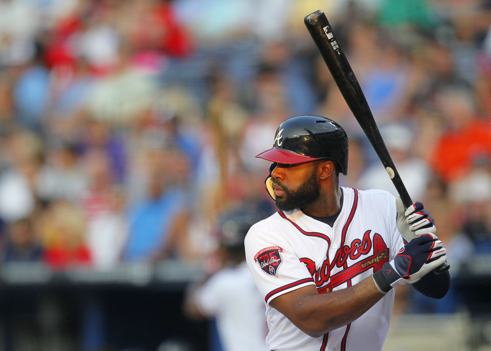 Photo - Atlanta Braves Jason Heyward  at bat in the third inning of a baseball game against the Philadelphia Phillies Monday, June 16, 2014, in Atlanta. (AP Photo/Todd Kirkland)