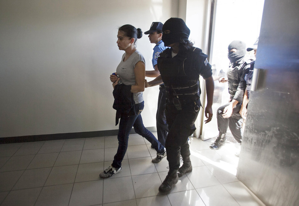 CORRECTS YEAR - Mexican citizen Raquel Alatorre Correa, alleged member of an organized crime group, is escorted to court for her sentence in Managua, Nicaragua, Friday, Jan. 18, 2013. A Nicaraguan judge has sentenced 18 Mexicans who posed as a television crew to 30 years in prison for drug trafficking and money laundering stemming from $9.2 million found in their news vans. (AP Photo/Mayerling Garcia)