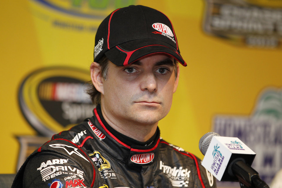 Photo -   Driver Jeff Gordon looks on during a news conference for Sunday's NASCAR Sprint Cup Series auto race at Homestead-Miami Speedway in Homestead, Fla., Friday, Nov. 16, 2012. (AP Photo/Terry Renna)