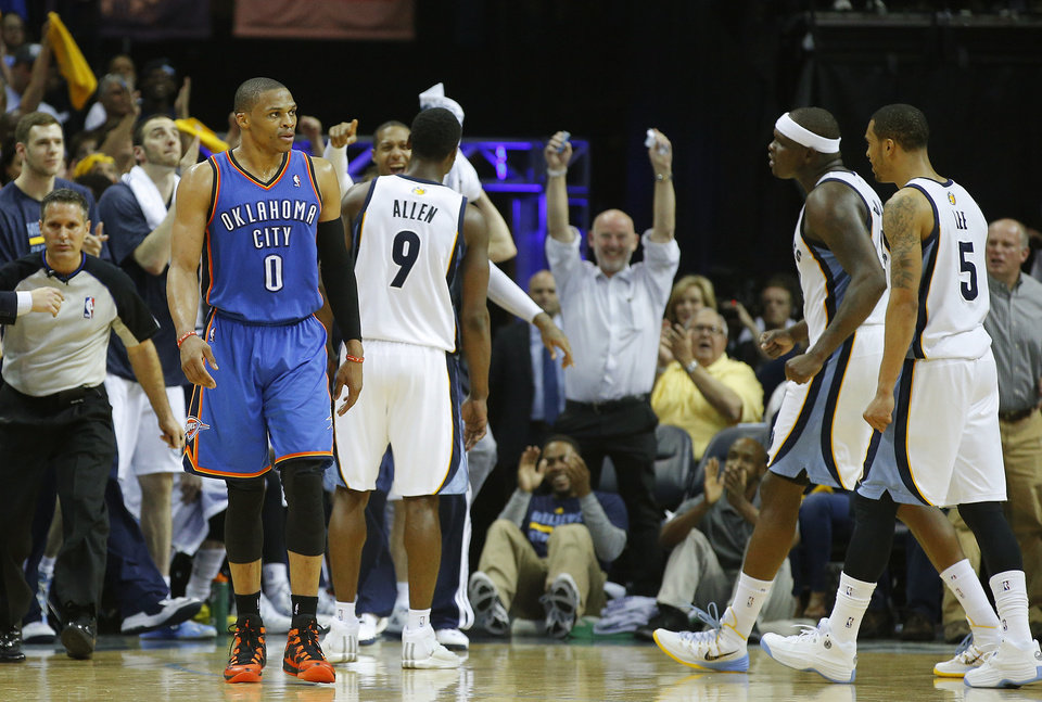 Photo - Oklahoma City's Russell Westbrook (0) walks away after missing a 3-point basket as Memphis' Tony Allen (9), Zach Randolph (50), and Courtney Lee (5) celebrate in overtime of Game 3 in the first round of the NBA playoffs between the Oklahoma City Thunder and the Memphis Grizzlies at FedExForum in Memphis, Tenn., Thursday, April 24, 2014. Memphis won 98-95. Photo by Bryan Terry, The Oklahoman