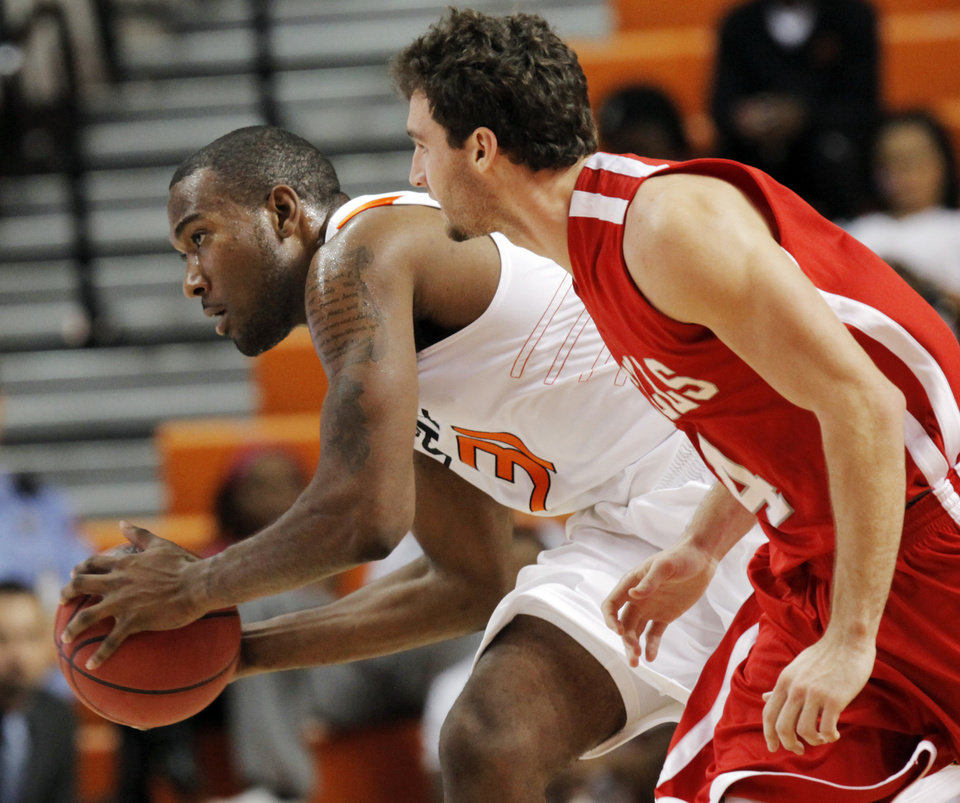OSU\'s Matt Pilgrim (31) looks to pass the ball away from Ben Martin (4) of Nicholls State in the first half during the men\'s college basketball game between Nicholls State University and Oklahoma State University at Gallagher-Iba Arena in Stillwater, Okla., Saturday, Nov. 21, 2010. Photo by Nate Billings, The Oklahoman