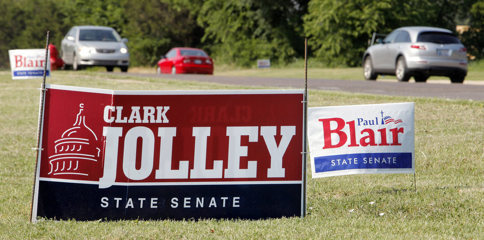 Photo - Senate District 41 candidate signs in the 3900 block of S. Boulevard in Edmond Tuesday, June 26, 2012.   Photo by Paul B. Southerland, The Oklahoman