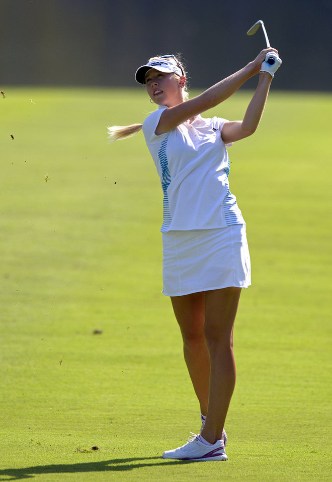 Photo - Jessica Korda hits her second shot from the 18th fairway in the final round of the Airbus LPGA Classic golf tournament at Magnolia Grove on Sunday, May 25, 2014, in Mobile, Ala. (AP Photo/G.M. Andrews)