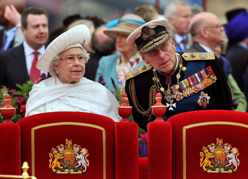 FILE - A Sunday June 3, 2012 photo from files showing Britain's Queen Elizabeth II, and her husband Prince Philip watching the proceedings from the royal barge during the Diamond Jubilee Pageant on the River Thames in London. Buckingham Palace says Prince Philip, husband of Queen Elizabeth II, has been hospitalized with a bladder infection. The 90-year-old prince has been taking part in celebrations of the queen�s Diamond Jubilee. (AP Photo/John Stillwell, Pool, File)