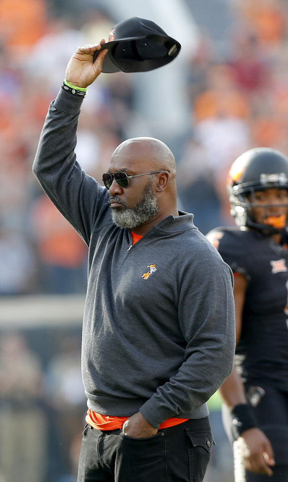 Photo - Thurman Thomas waves to the crowd during the Bedlam college football game between the Oklahoma State Cowboys and the Oklahoma Sooners at Boone Pickens Stadium in Stillwater in 2017. [Sarah Phipps, The Oklahoman]