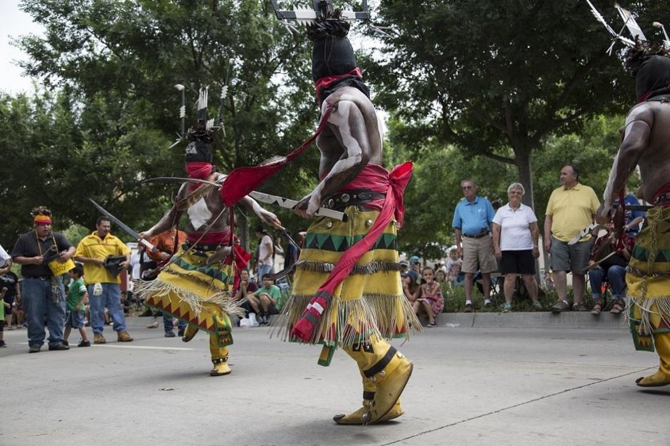 Photo - Apache Crown Dancers participate in the 2018  Red Earth Festival parade, which celebrates Native American culture, in Oklahoma City, Friday, June 8, 2018. [The Oklahoman Archives photo]