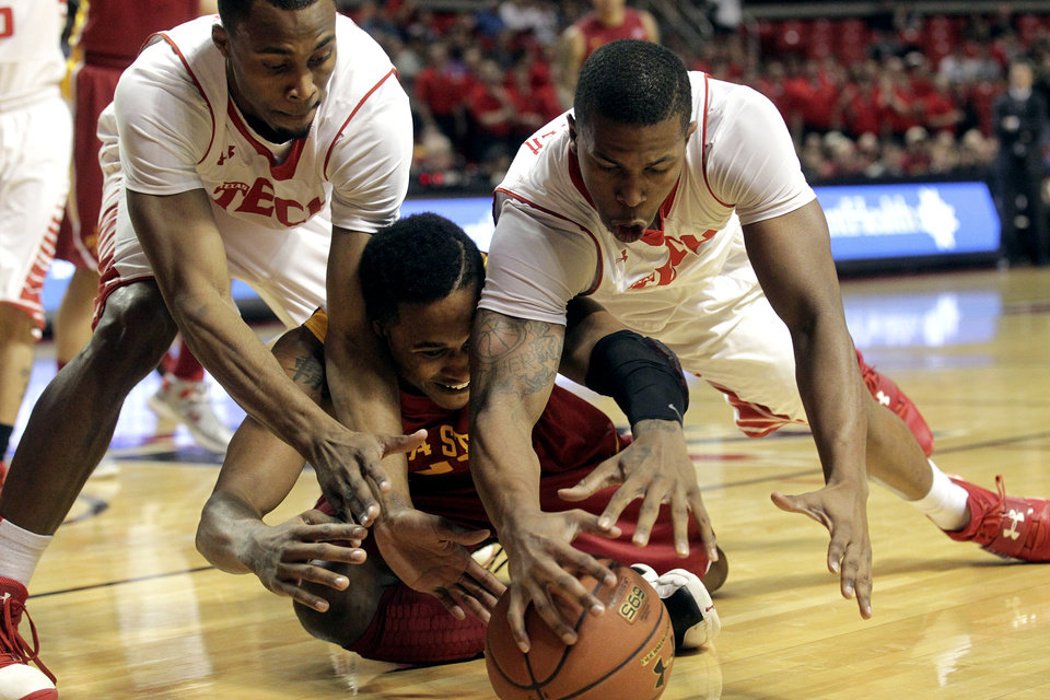 Texas Tech's Jaye Crockett and Toddrick Gotcher battle for the ball with Iowa State's Tyrus McGee, bottom, during their NCAA college basketball game, Wednesday, Jan. 23, 2013, in Lubbock, Texas. (AP Photo/The Avalanche-Journal, Stephen Spillman) ALL LOCAL TV OUT