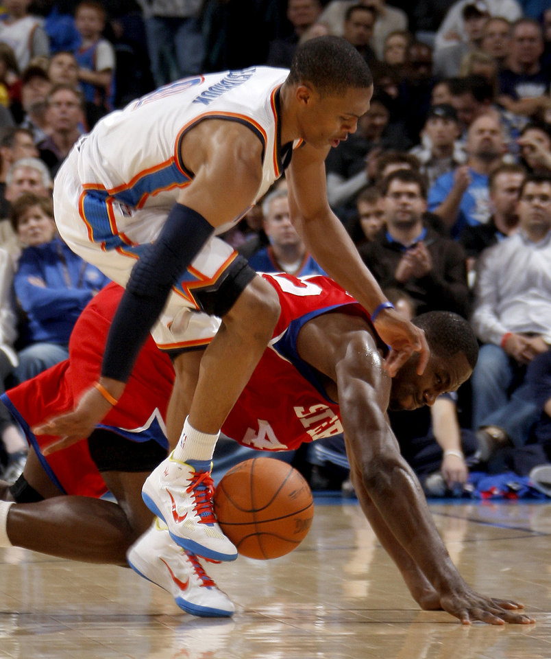 Photo - Oklahoma City's Russell Westbrook and Philadelphia's Elton Brand go for the ball during the NBA basketball game between the Oklahoma City Thunder and the Philadelphia 76ers at the Oklahoma City Arena on Wednesday, Nov. 10, 2010.   Photo by Bryan Terry, The Oklahoman ORG XMIT: KOD