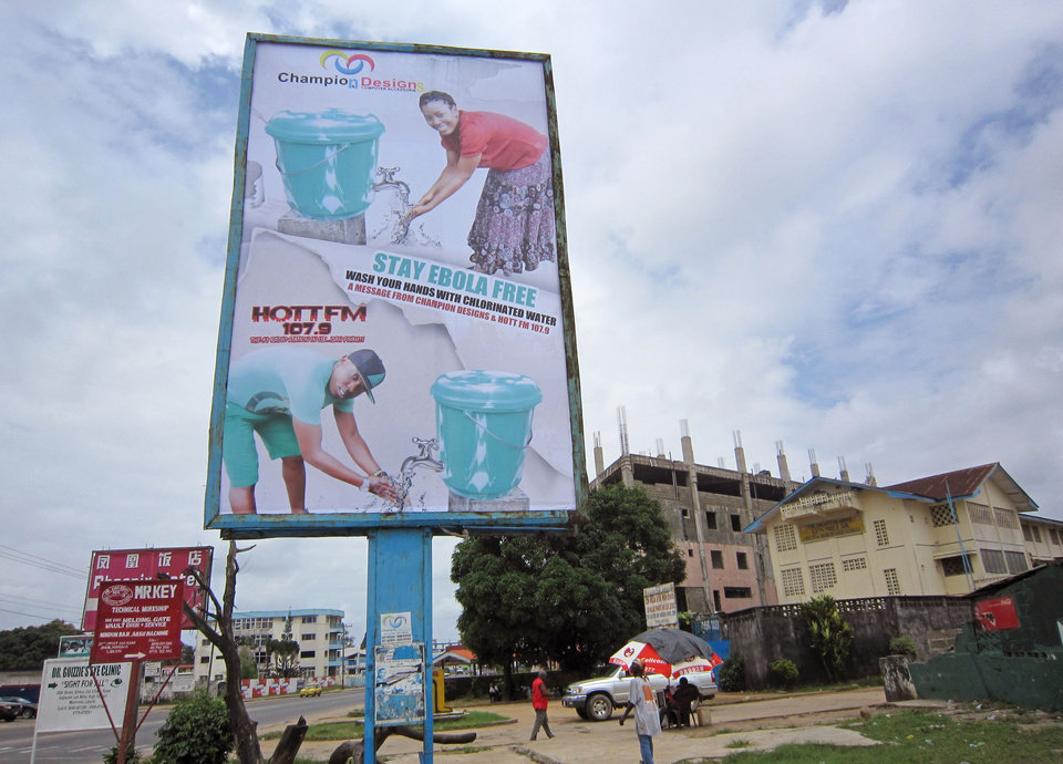 Photo - In this image taken Saturday, Aug. 9, 2014 a large billboard promoting the washing of hands to prevent the spread of the deadly Ebola virus in Monrovia, Liberia. Over the decades, Ebola cases have been confirmed in 10 African countries, including Congo where the disease was first reported in 1976. But until this year, Ebola had never come to West Africa. (AP Photo/Jonathan Paye-Layleh)