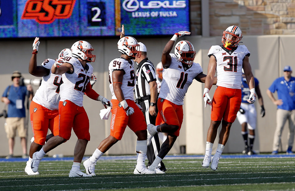 Photo - Oklahoma State defensive celebrates a Kolby Harvell-Peel (31) sack during a college football game between the Oklahoma State University Cowboys (OSU) and the University of Tulsa Golden Hurricane (TU) at H.A. Chapman Stadium in Tulsa, Okla., Saturday, Sept. 14, 2019. [Sarah Phipps/The Oklahoman]