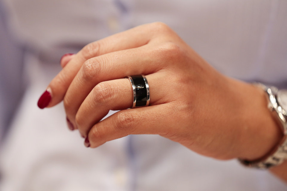Photo - A woman wears a prototype of the Mota Smart Ring at the consumer electronic fair IFA in Berlin, Germany, Friday, Sept. 5, 2014. The smart ring is designed to notify users about incoming messages and phone calls.  (AP Photo/Markus Schreiber)