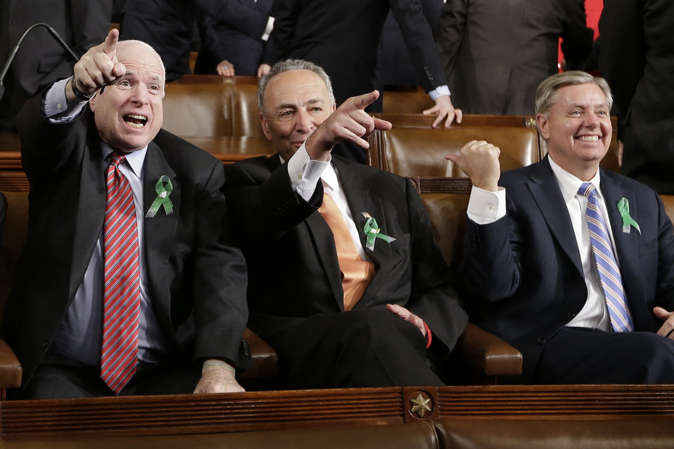 Photo - From left, Sen. John McCain, R-Ariz., Sen. Charles Schumer, D-N.Y. and Sen. Lindsey Graham, R-S.C. sit on Capitol Hill in Washington, Tuesday, Feb. 12, 2013, before President Barack Obama's State of the Union address during a joint session of Congress . (AP Photo/Charles Dharapak, Pool)