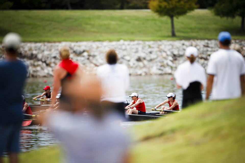 Photo - Fans watch as two teams battle for first in the Women's Club C 8+ final during the USRowing Masters National Championships on the Oklahoma River on Saturday, Aug. 13, 2011. Photo by Zach Gray, The Oklahoman