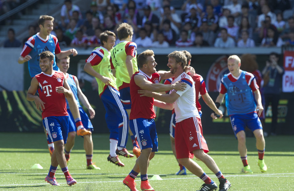 Photo - Bayern Munich soccer players react after winning a drill during practice at Providence Park in Portland, Ore., Tuesday, Aug. 5, 2014. MLS players will face Bayern Munich in the All-Star game on Wednesday night in Portland. (AP Photo/The Oregonian, Randy l. Rasmussen)  MAGS OUT; TV OUT; LOCAL TELEVISION OUT; LOCAL INTERNET OUT; THE MERCURY OUT; WILLAMETTE WEEK OUT; PAMPLIN MEDIA GROUP OUT