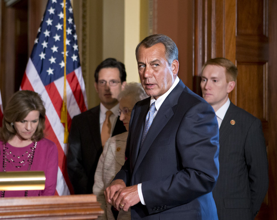 Photo - House Speaker John Boehner of Ohio, accompanied by fellow members of the House GOP leadership, responds to President Barack Obama's remarks to the nation's governors earlier today about how to fend off the impending automatic budget cuts, Monday, Feb. 25, 2013, on Capitol Hill in Washington. From left are, Rep. Lynn Jenkins, R-Kansas, House Majority Leader Eric Cantor of Va., Rep. Virginia Foxx, R-N.C., Boehner, and Rep. James Lankford, R-Okla. (AP Photo/J. Scott Applewhite)