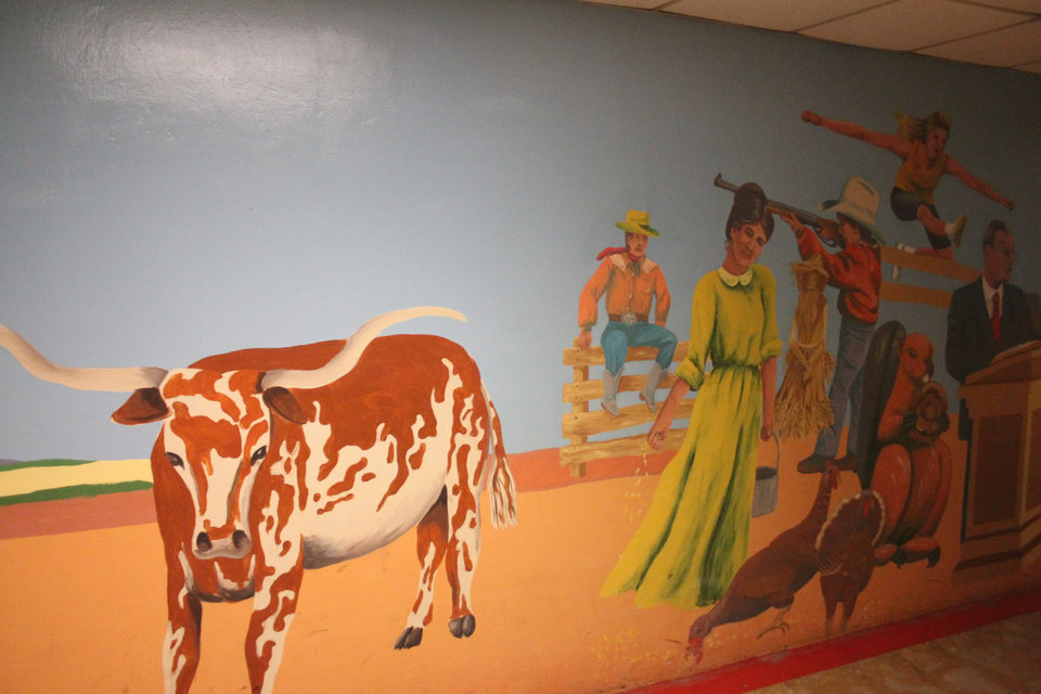 Photo - Murals on both sides of the 650-foot-tunnel illustrate the state's six regional areas. The underground passageway runs from the east side of the state Capitol that goes underneath N Lincoln Boulevard to parking lots on the east side of the street.  BY MICHAEL MCNUTT - THE OKLAHOMAN