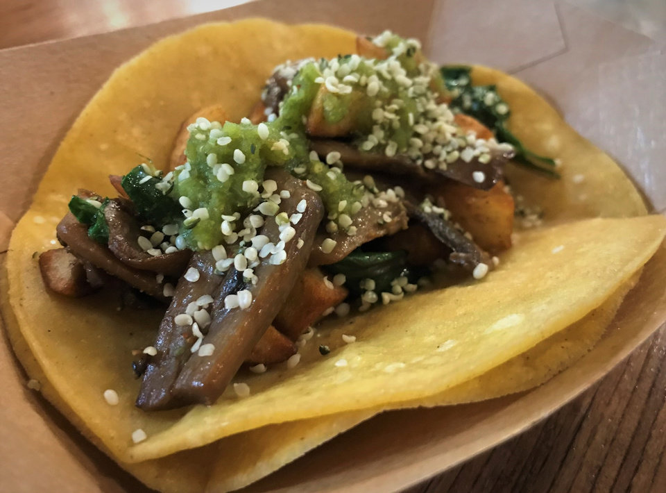 Photo - This vegan taco with mushrooms and potatoes isn't on the regular menu at Taqueria El Camino but vegan options abound. [Dave Cathey/The Oklahoman]