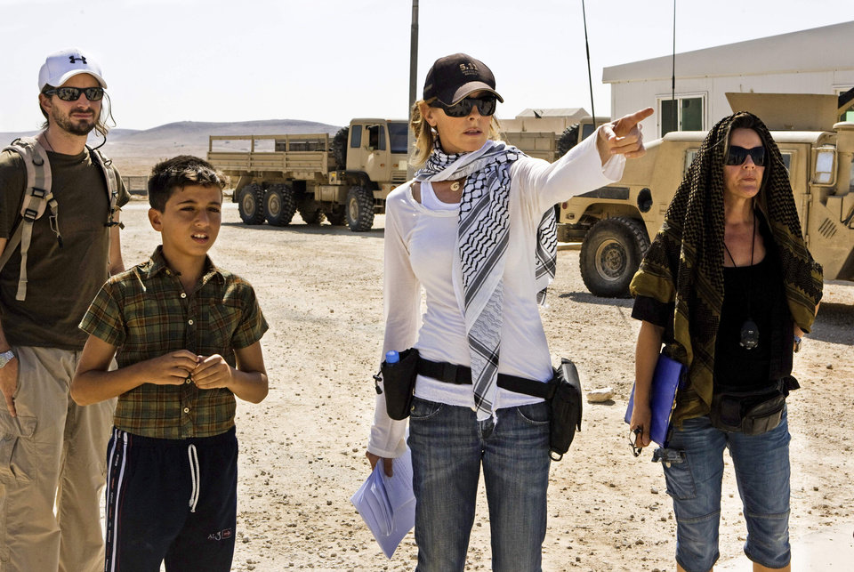 "In this film publicity image released by Summit Entertainment, director Kathryn Bigelow, center, is shown on the set of ""The Hurt Locker."" Bigelow was nominated Tuesday, Feb. 2, 2010 for an Oscar for best director for, ""The Hurt Locker."" The 82nd Academy Awards will be presented on March 7. (AP Photo/Summit Entertainment) ** NO SALES ** ORG XMIT: NYET679"
