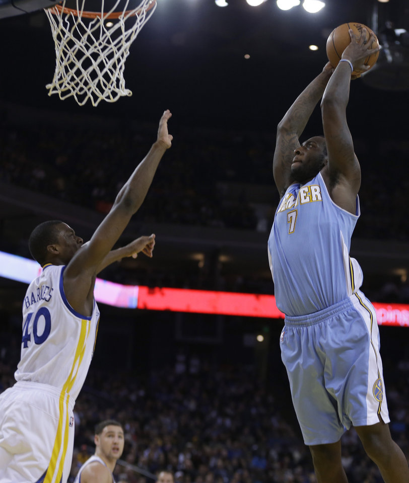 Photo - Denver Nuggets' J.J. Hickson, right, shoots over Golden State Warriors' Harrison Barnes (40) during the second half of an NBA basketball game on Wednesday, Jan. 15, 2014, in Oakland, Calif. (AP Photo/Ben Margot)