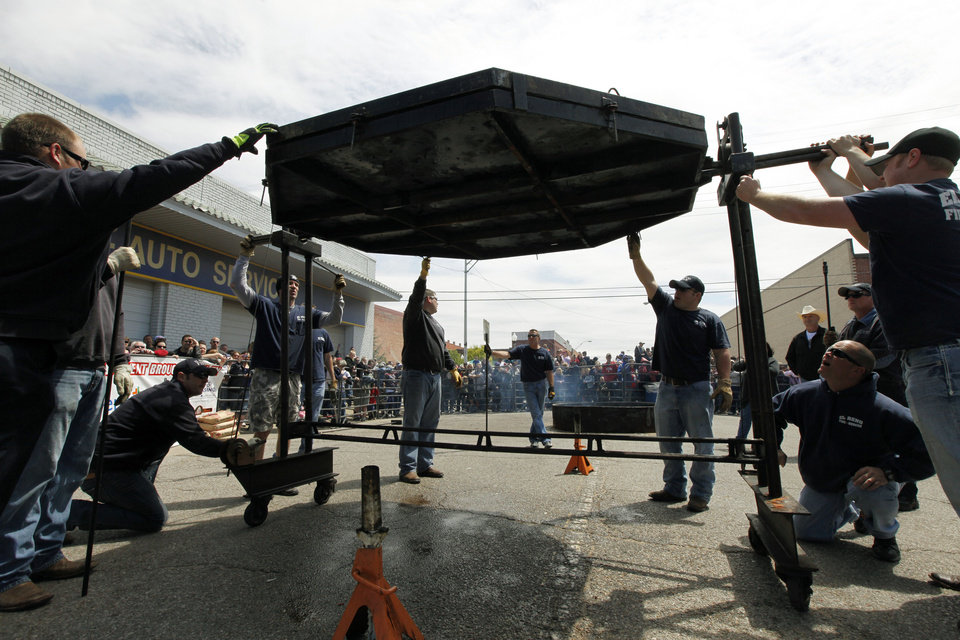 A 750 lb. burger is carefully flipped during the Fabulous Burger Day Festival in El Reno, OK, Saturday, May 4, 2013, By Paul Hellstern, The Oklahoman