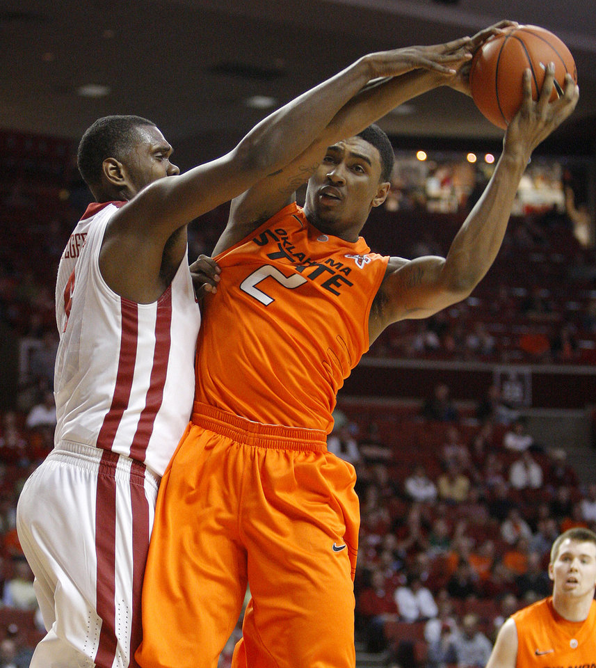 Oklahoma State's Le'Bryan Nash (2) grabs a rebound beside Oklahoma's Andrew Fitzgerald (4) during the Bedlam men's college basketball game between the University of Oklahoma Sooners and the Oklahoma State Cowboys in Norman, Okla., Wednesday, Feb. 22, 2012. Photo by Bryan Terry, The Oklahoman