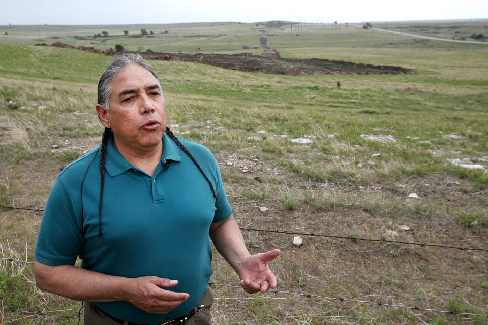 Photo -  Raymond Lesley II, Executive Advisor of Programs for the Osage Nation, talks on one of the proposed wind farm sites.    David McDaniel -  The Oklahoman