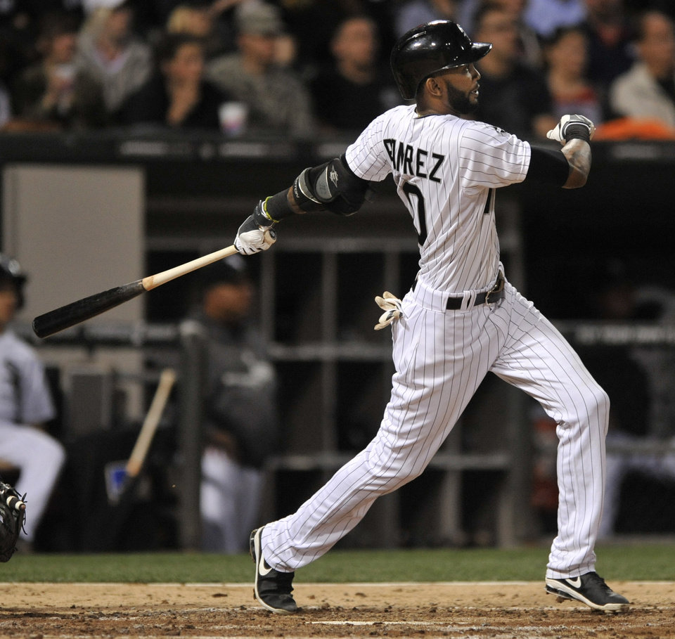Photo - Chicago White Sox's Alexei Ramirez watches his grand slam during the fourth inning of a baseball game against the Arizona Diamondbacks in Chicago, Friday, May 9, 2014. (AP Photo/Paul Beaty)